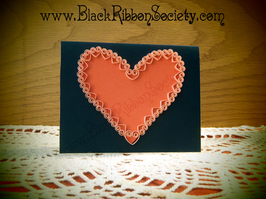 Black Ribbon Society's Quilled Valentine's-Navy Color Paper affixed to Cardstock with Red main Heart design & small Pink Quilled Hearts