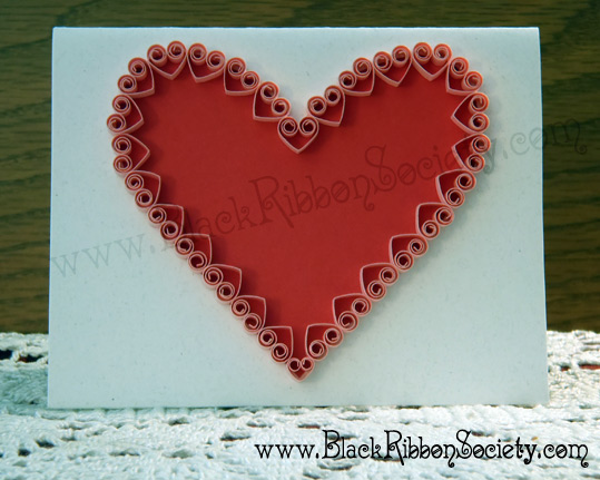 Black Ribbon Society's Quilled Valentine's-Natural White with Fibers Paper affixed to Cardstock with Red main Heart design & small Pink Quilled Hearts