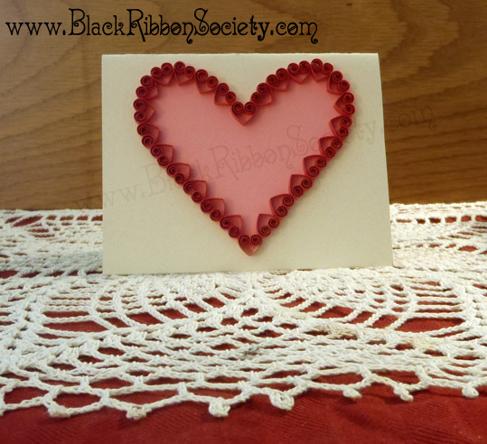 Black Ribbon Society's Quilled Valentine's-Eggshell White Paper affixed to Cardstock with Pink main Heart design & small RedQuilled Hearts